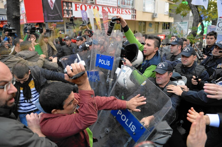 Police use pepper spray on demonstrators in Ankara, Turkey, during a protest against the arrest of two journalists at the newspaper Cumhuriyet on spying charges. The paper had reported that Turkey's intelligence agency had covertly sent weapons to Islamist rebels in Syria.