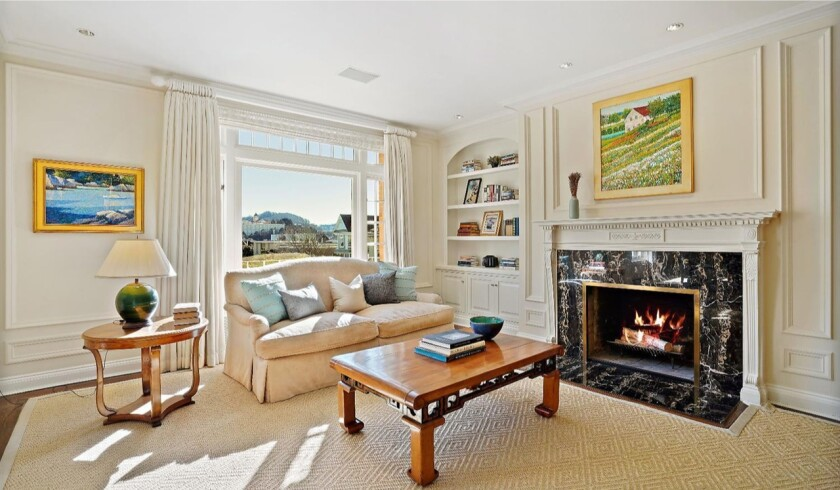 Living room with a fireplace and expansive view.