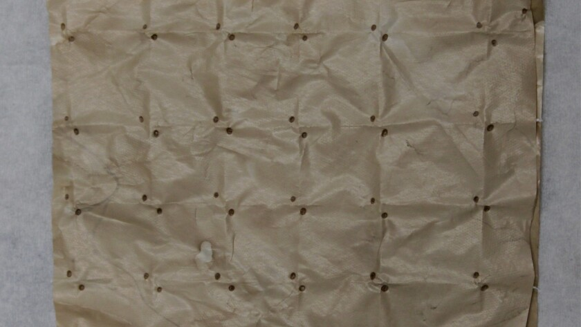 The nanoporous polyethylene cloth developed at Stanford deflects heat from the sun while allowing body heat to escape.