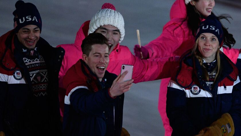 Shaun White takes a selfie with his compatriots during the opening ceremony of the 2018 Winter Games.