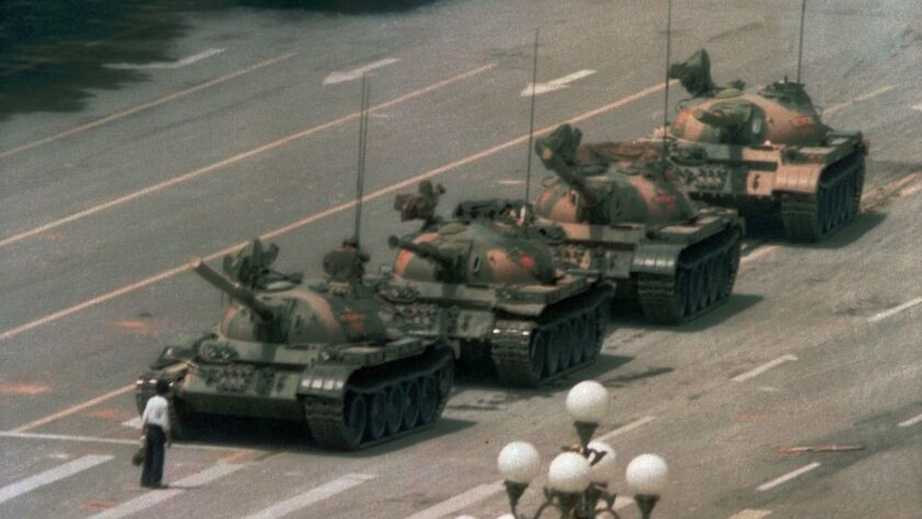 FILE - In this June 5, 1989 file photo, a Chinese man stands alone to block a line of tanks heading
