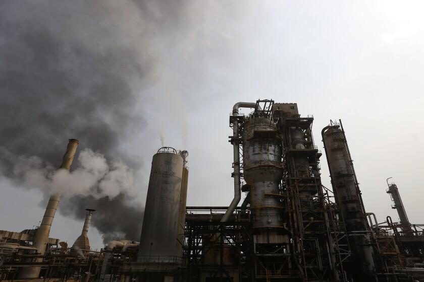 The El Palito refinery belches out smoke near Puerto Cabello in Venezuela, Monday, May 25, 2020. (AP Photo/Ernesto Vargas)