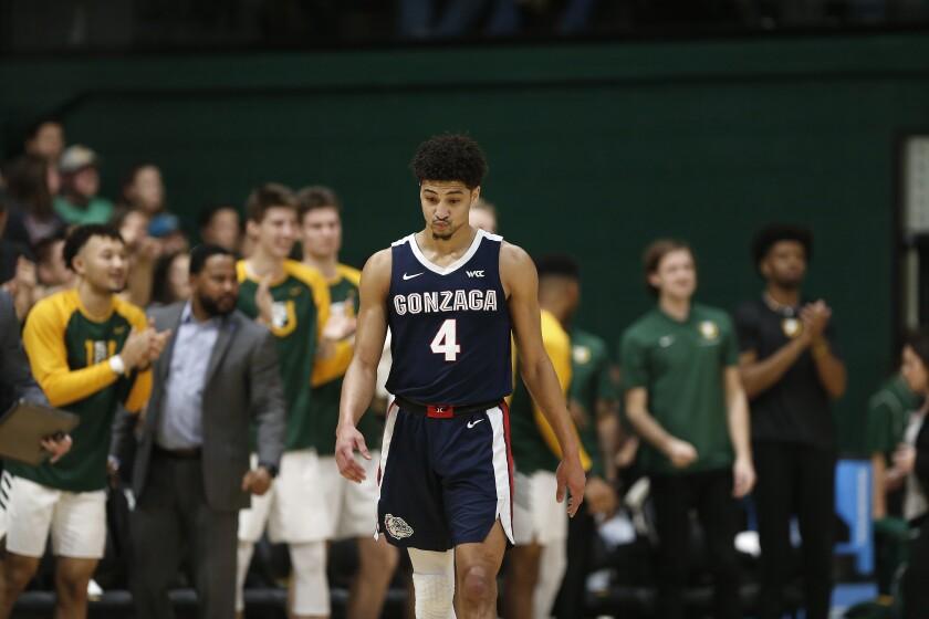 Gonzaga guard Ryan Woolridge (4) reacts during the first half of an NCAA college basketball game against San Francisco in San Francisco, Saturday, Feb. 1, 2020. (AP Photo/Jed Jacobsohn)
