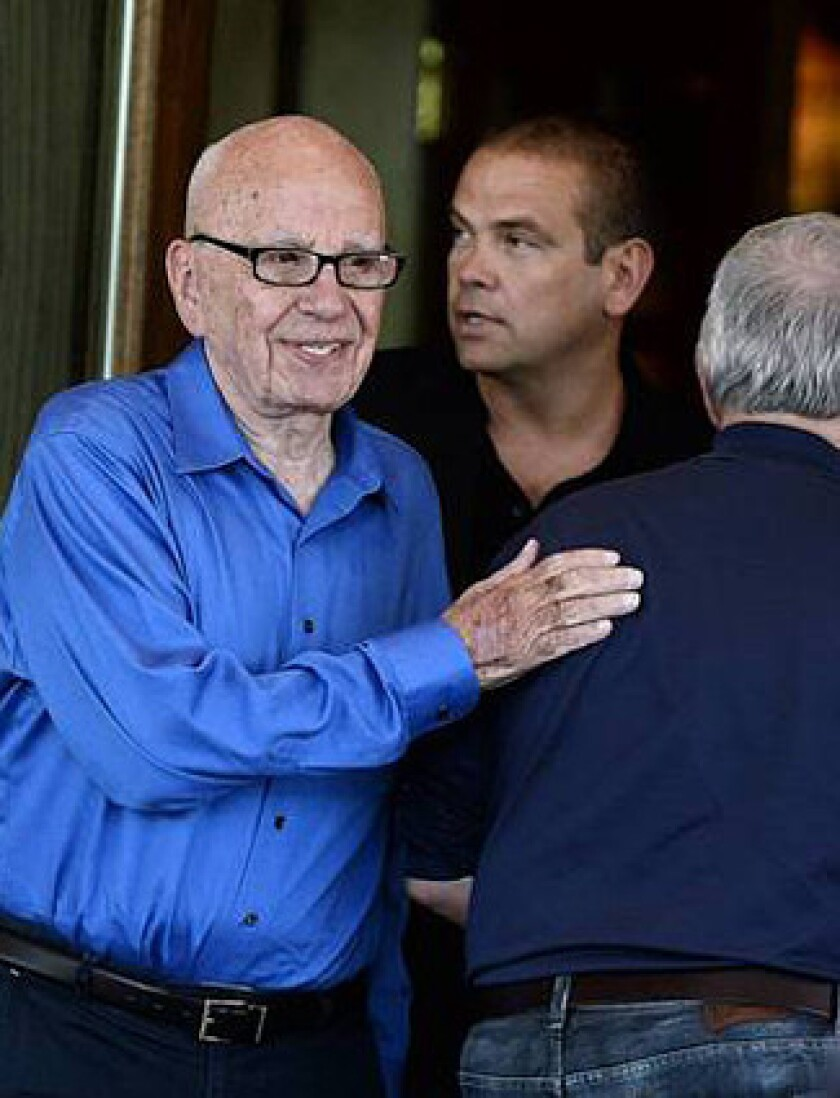 News Corp. Chairman Rupert Murdoch, left, was invited to appear before members of the British Parliament to explain his comments on the secret recording. Shown with him is son Lachlan Murdoch.