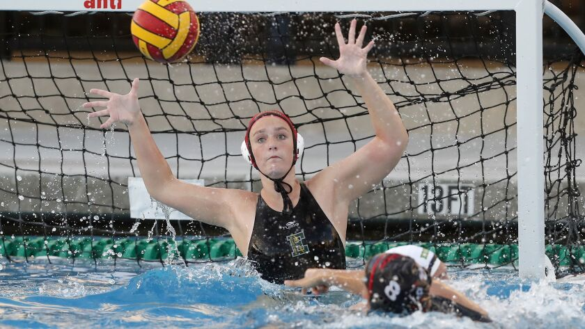 Edison High goaliekeeper Coryn Cavechee defends the net against Troy during the first half in the fi