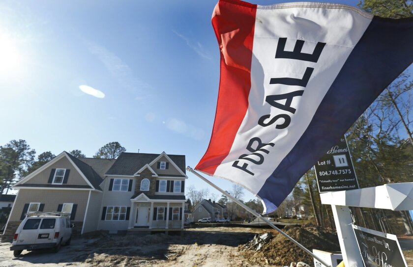 FILE - In this Jan. 8, 2015 file photo, a flag advertising a newly built home for sale flaps in the breeze in Richmond, Va. The Commerce Department releases new home sales for March on Thursday, April 23, 2015. (AP Photo/Steve Helber, File)