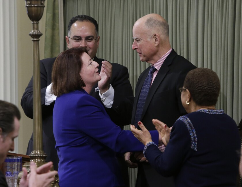 Assembly Speaker Toni Atkins (D-San Diego), pictured here with Gov. Jerry Brown shortly after being sworn into her new leadership role last year, detailed new budget priorities for her caucus Tuesday.
