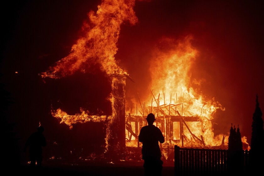 A home burns as the Camp Fire rages through Paradise, Calif.