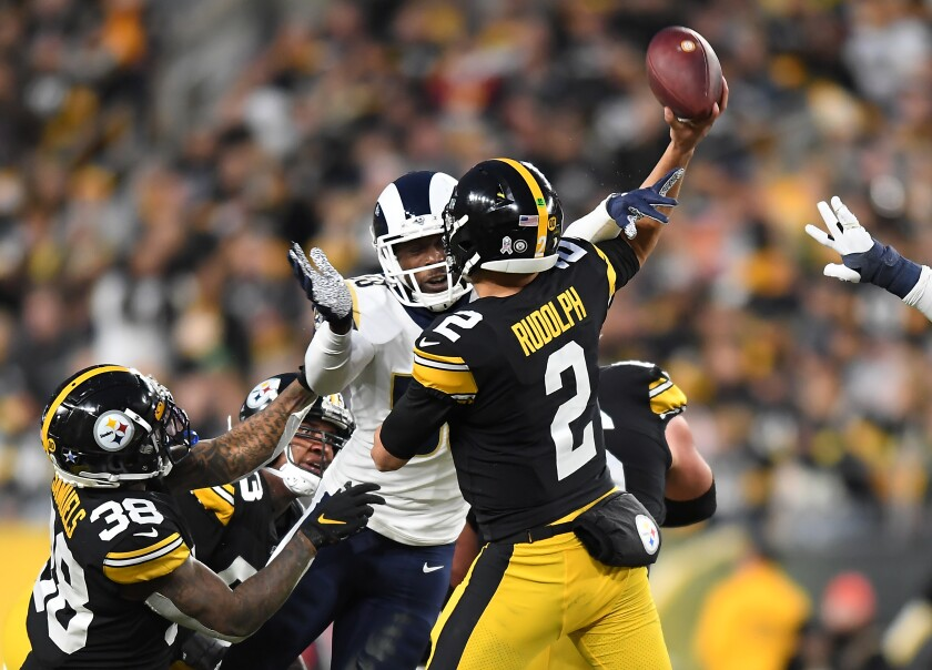 Rams linebacker Cory Littleton hits the arm of Steelers quarterback Mason Rudolph to force an incomplete pass in the second quarter.