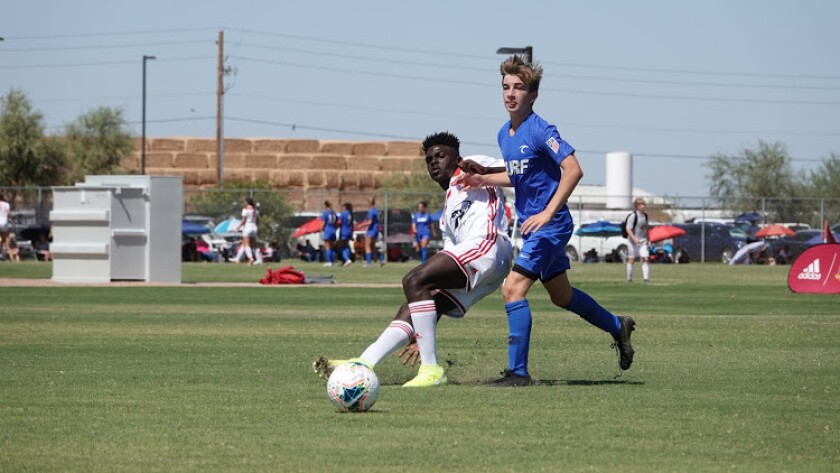 Dane Peterson, right, marks his man in a boys' 14-and-under soccer match while playing for the O.C. Surf.
