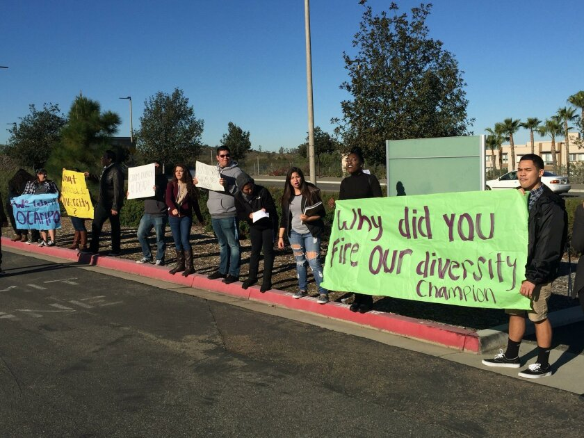 Cal State San Marcos University students hold signs protesting the dismissal of Arturo Ocampo, head of the Office of Diversity, Educational Equity and Inclusion, outside CSUSM President Karen Haynes' speech last week.