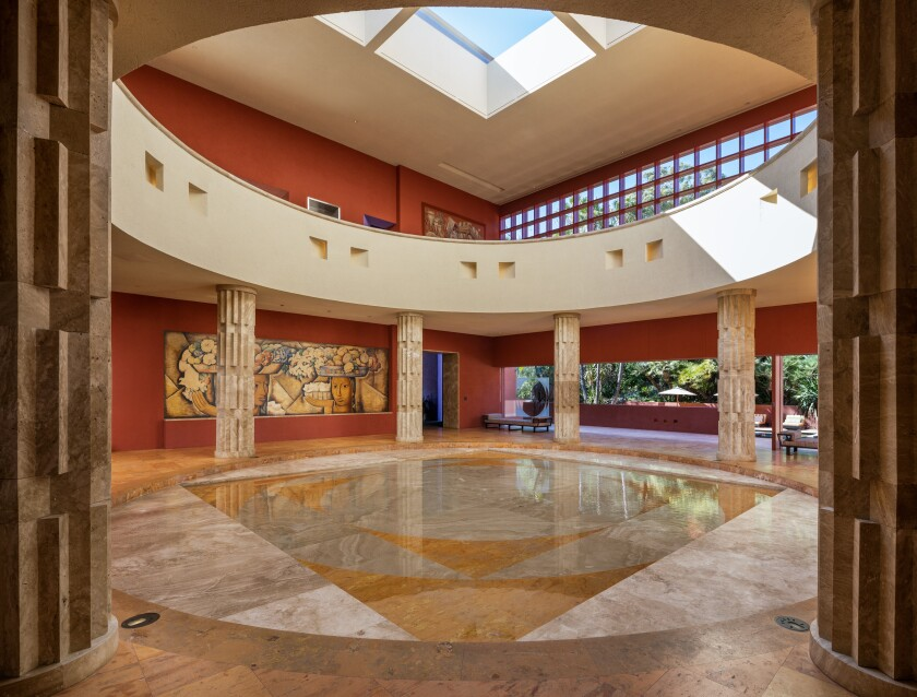 Skylights top the atrium at the Brentwood house film producer Joel Silver has listed for sale.
