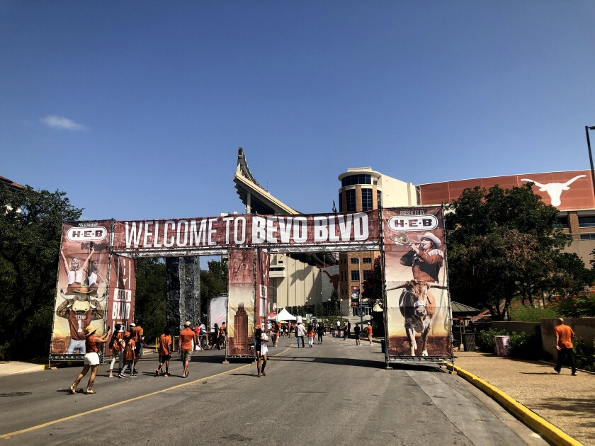 Fans pose for photos outside the Texas Longhorns' stadium.