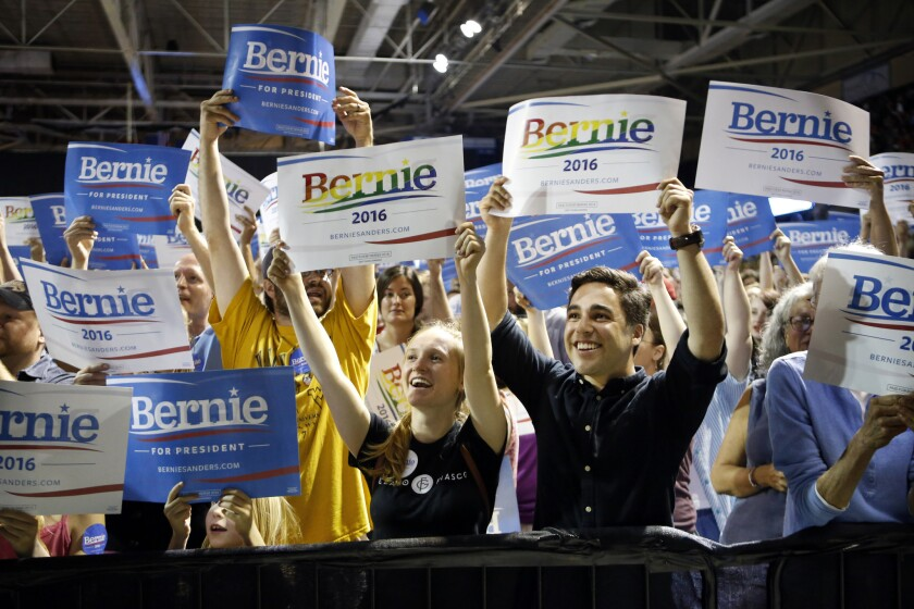 Supporters of Democratic presidential candidate Bernie Sanders cheer at a campaign rally in Portland, Maine.