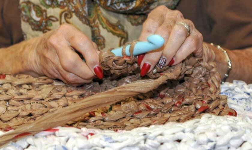 Closeup of a sleeping mat being woven out of plastic bags from supermarkets by a resident at The Fountains at La Cholla senior retirement community in Tucson, Arizona; these soft and comfortable mats are then donated to the homeless. EFE-EPA/Gary Williams