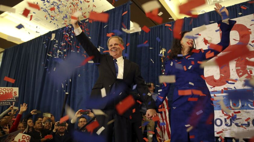 Democratic Senate candidate Doug Jones and his wife Louise wave to supporters in Birmingham, Ala. on Dec. 12, 2017.