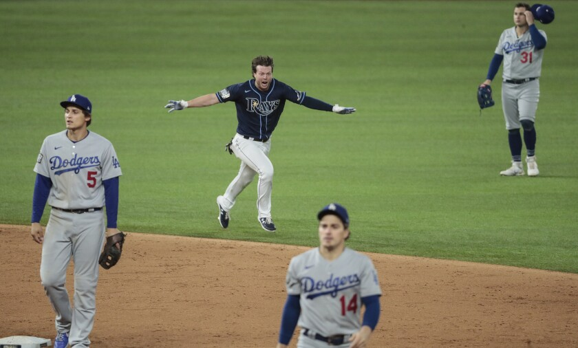 Brett Phillips dashes across the field after his game-winning hit against the Dodgers in Game 4 on Saturday.