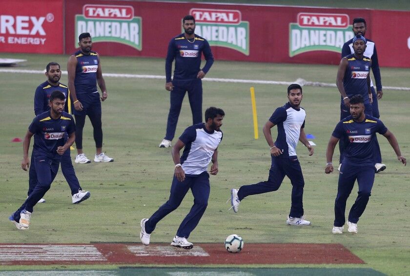 Sri Lankan cricket team players attend a practice session at Gaddafi Stadium in Lahore, Pakistan, Sunday, Oct. 6, 2019. Sri Lanka will play a second Twenty20 match against Pakistan on Monday. (AP Photo/K.M. Chaudary)