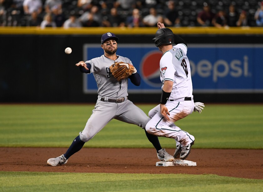 Greg Garcia attempts to turn a double play as the Diamondbacks' Carson Kelly is forced out at second base. Garcia is starting at shortstop Wednesday for the third time in four games.