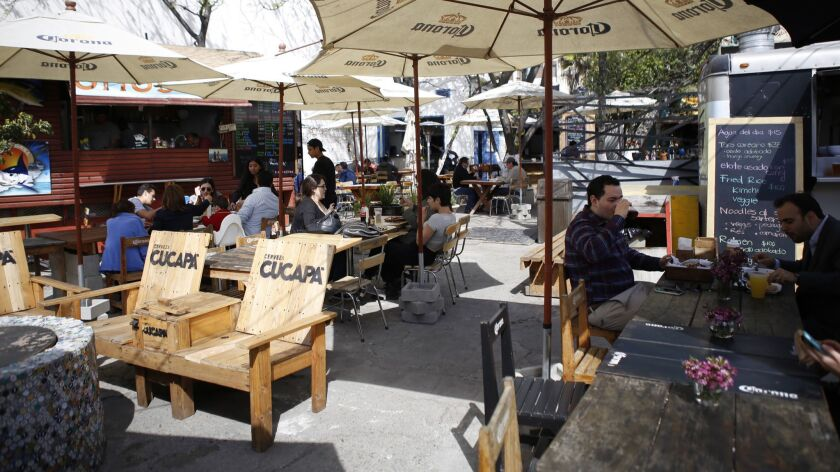 Telefonica Gastro Park in downtown Tijuana, with its large variety of culinary offerings, has been a popular destination for visitors, but business is down since the arrival of large groups of Central American migrants in Tijuana.