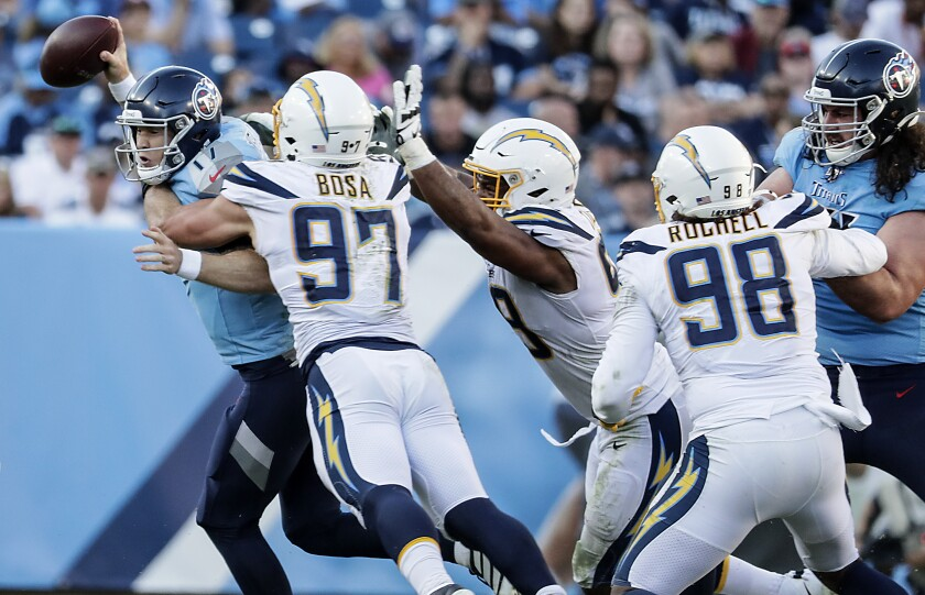 Chargers defensive end Joey Bosa (97) sacks Tennessee Titans quarterback Ryan Tannehill (17) during second half on Sunday in Nashville.