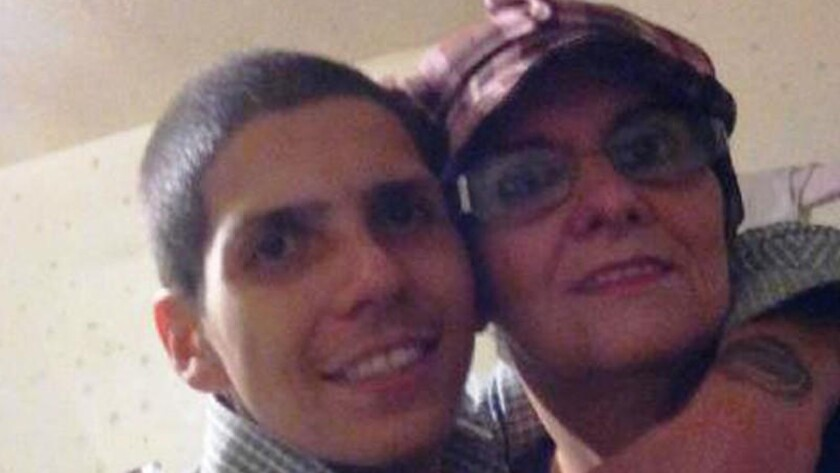 Hector Morejon, who was shot and killed by a Long Beach police officer in April 2015, is shown in a family photo with his mother, Lucia. Prosecutors sharply criticized Officer Jeffrey Meyer's actions leading up to the shooting but declined to file charges.