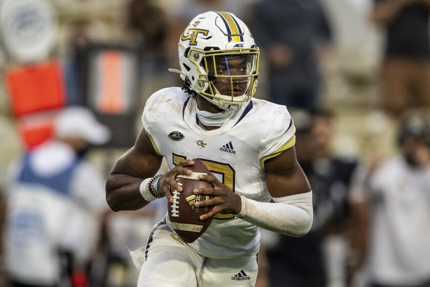 FILE - In this Sept 19, 2020, file photo, Georgia Tech quarterback Jeff Sims (10) looks to pass against UCF during an NCAA college football game in Atlanta. Georgia Tech offensive coordinator and quarterbacks coach Dave Patenaude sees a new-found confidence in Jeff Sims as Sims is set to open his second season as the Yellow Jackets' starter against Northern Illinois on Saturday night. Patenaude says he has been amazed by Sims' understanding of the offense and belief in his skills in preseason practice. (AP Photo/Danny Karnik, File)