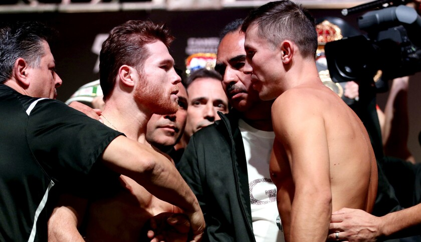 Canelo Alvarez, center left, and Gennady Golovkin face off during a weigh-in at T-Mobile Arena in La