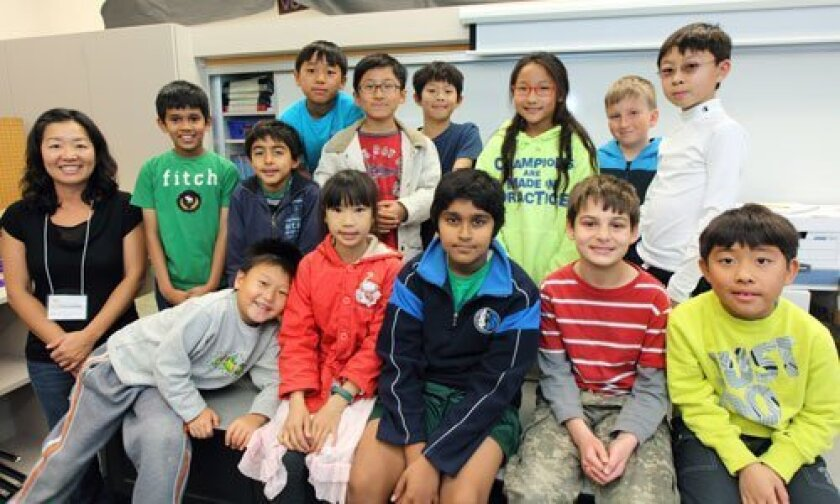 Sycamore Ridge Math Club members: From left to right, bottom row up: Bottom: Derek, Catherine, Nikhil, Demir, Ryan; Middle: Carol Moon, Yash, Omar, Brian, Emily, Justin; Top: Sho, Eric, Ben
