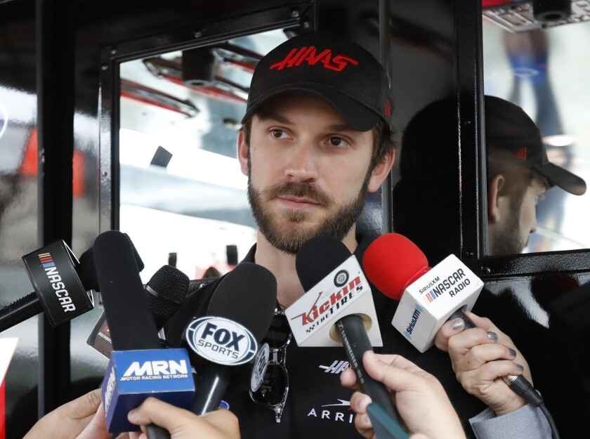 FILE - In this Nov. 15, 2019, file photo, Daniel Suarez talks to the media before practice for a NASCAR Cup Series auto race at Homestead-Miami Speedway in Homestead, Fla. Former driver Justin Marks has started a new NASCAR team that will field a car in 2021 for Daniel Suarez. The team announced Wednesday, Oct. 7, 2020, will be called Trackhouse Racing and field the No. 99 Chevrolet for Suarez. (AP Photo/Terry Renna)