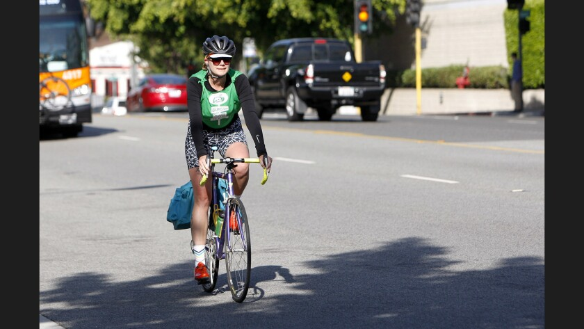 Rosalind Morehead, of South Pasadena, rode her bike from home to her job at D.C. Comics, at the Pointe, on the 2900 block of West Alameda, in Burbank on Thursday, May 18, 2017. The Burbank Transportation Management Organization hosted a pit stop at this location and two other bike pit stops elsewhere in Burbank for the annual Bike & Walk to Work Day.