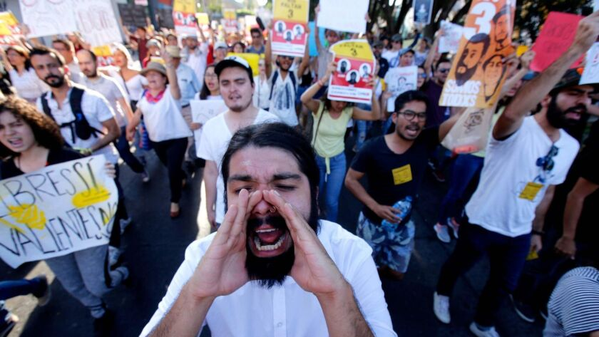 The disappearance of three film students in Guadalajara, in Mexico's Jalisco state, has prompted large and angry protests, like this one Saturday.