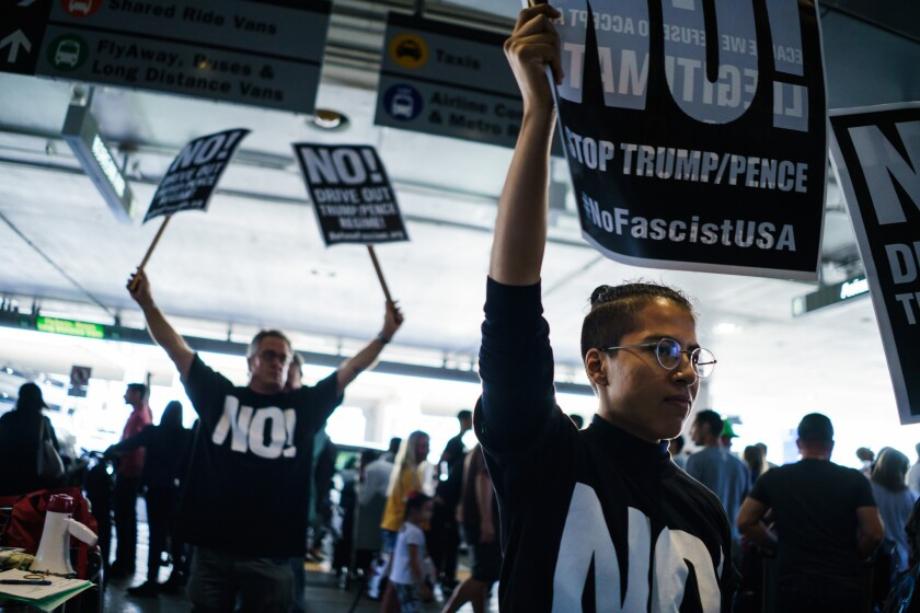Tala Deloria, right, and other protesters at LAX's Tom Bradley International Terminal oppose the travel ban taking effect at 5 p.m. June 29.