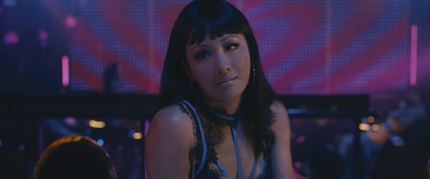 "Constance Wu as Destiny in ""Hustlers."""