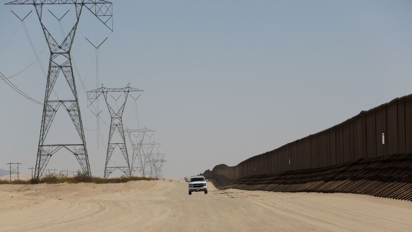 "A Border Patrol agent drives along the ""floating fence"" between Calexico, Calif. and Yuma, Ariz. Operation Blazing Sands began in August to prevent human smuggling along a 20-mile stretch of border between Calexico and Yuma."