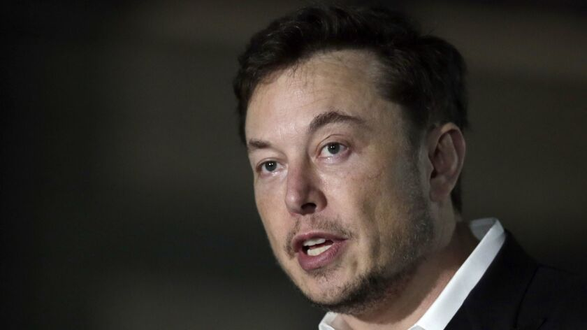 Tesla CEO and founder of the Boring Co., Elon Musk, speaks at a news conference in Chicago on June 14, 2018. Musk announced Tuesday, Aug. 7, that he is considering taking the electric car maker private.