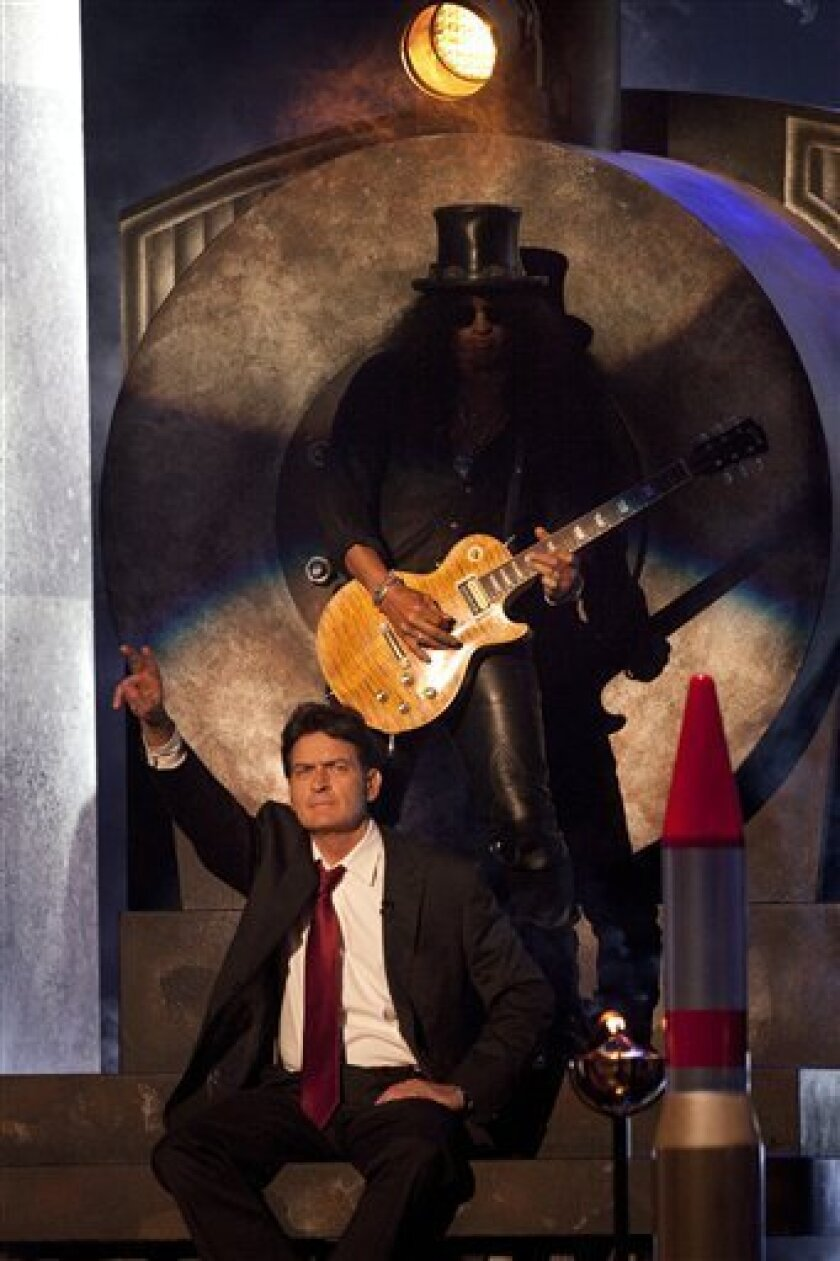 """Charlie Sheen is seen with Slash at the """"Comedy Central Roast of Charlie Sheen"""" on Saturday, Sept. 10, 2011 in Culver City, Calif. (AP Photo/Dan Krauss)"""