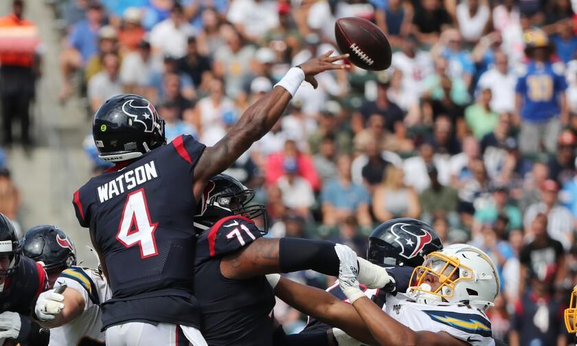 Houston Texans quarterback Deshaun Watson throws a pass.