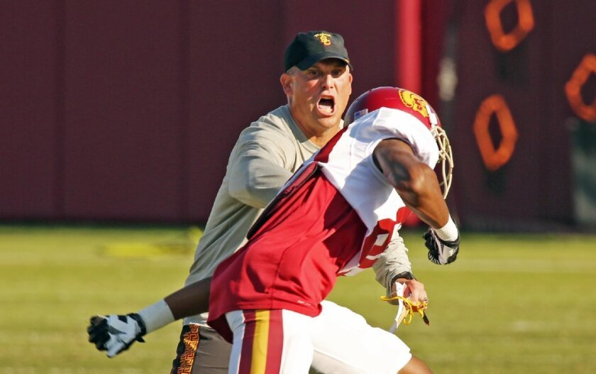 The USC Trojans resumed practice Tuesday under interim Coach Clay Helton.
