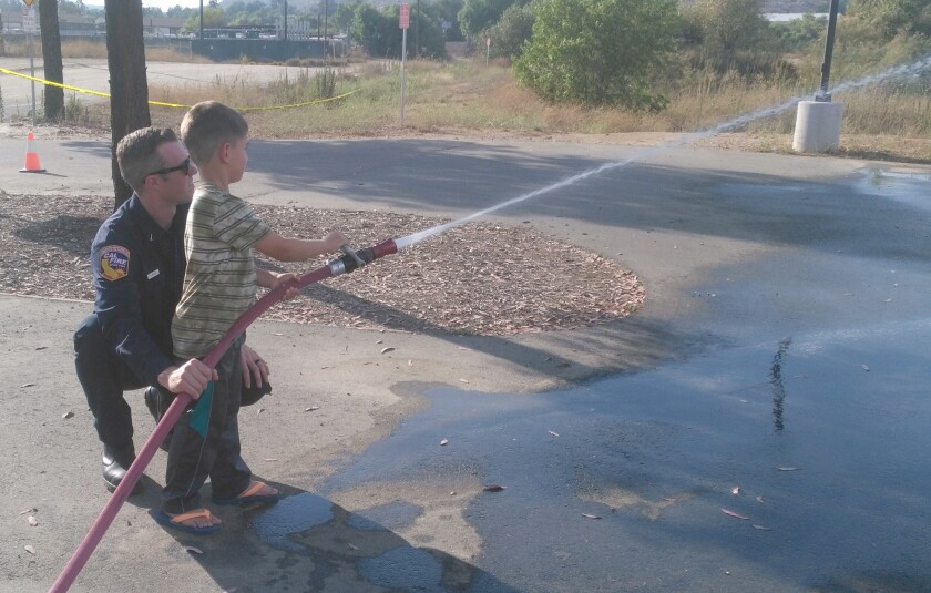 Copy - Boy with Fire Hose.jpg