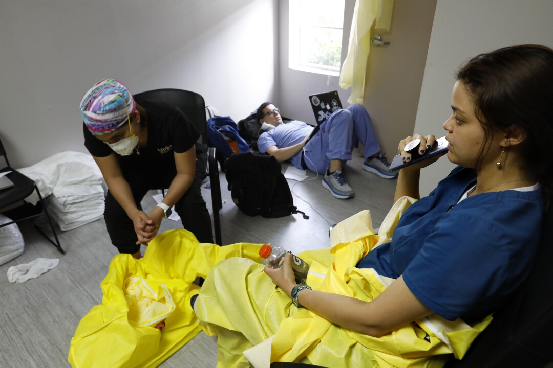 Medical students rest while on a short break from their work on the COVID-19 ward.