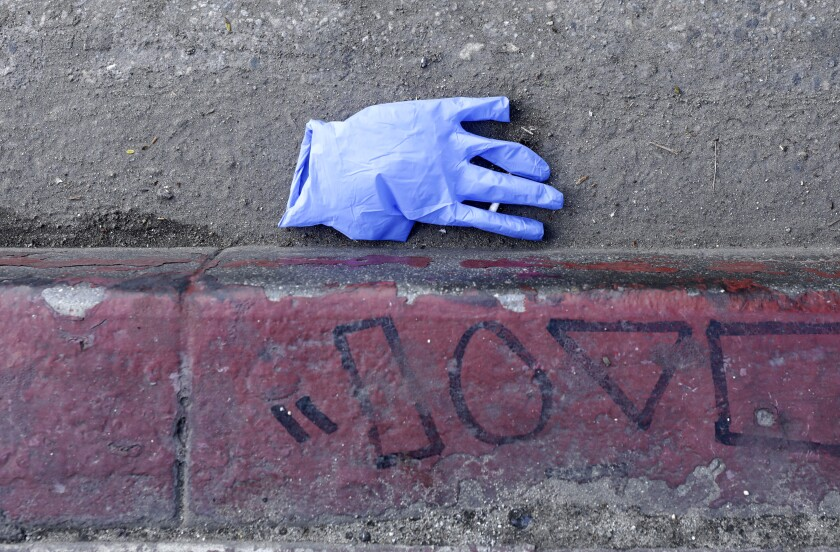 A discarded glove on the street