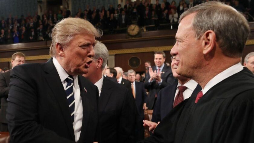 President Trump shakes hands with Chief Justice John G. Roberts Jr. before delivering his first address to a joint session of Congress on Feb. 28, 2017.