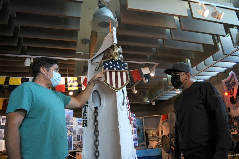 Navy veterans Joe Frangiosa, left, and Julian Ospina discuss coping with PTSD at the Bonita Museum and Cultural Center.