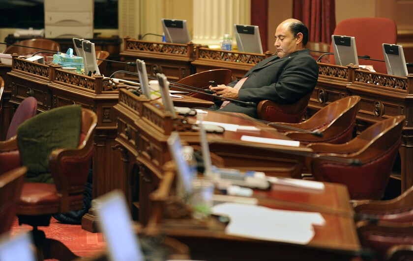 Sen. Lou Correa (D-Santa Ana), here checking a message in the Senate chambers in 2009, could not secure enough votes Monday to pass a campaign finance disclosure bill.