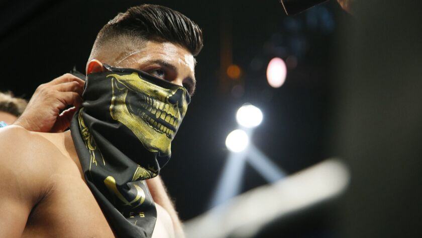 Abner Mares wears a skeleton bandana around his face before fighting against Leo Santa Cruz in their WBC diamond featherweight and WBA featherweight championship boxing bout on Aug. 29, 2015, in Los Angeles.