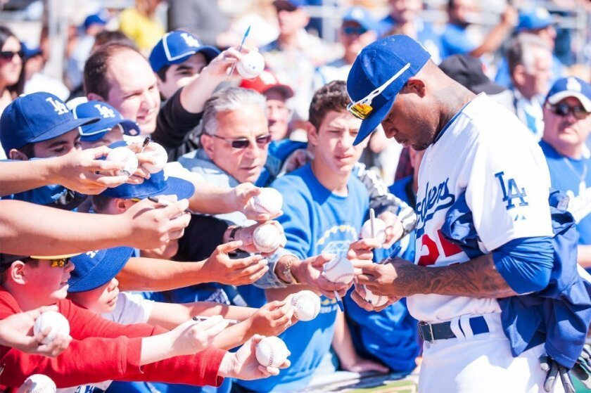 Carl Crawford signs some autographs at spring training.