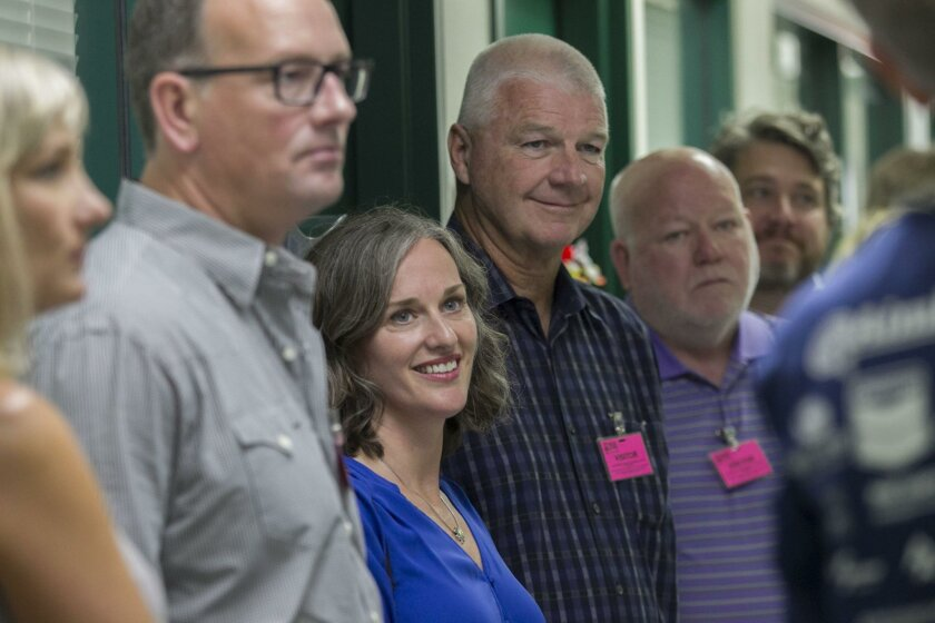 Pat and Stephanie Kilkenny, the couple at center, listened as Ruth Bruland explains the dental program at Father Joe's Villages during a tour of the downtown facility on Aug. 26.