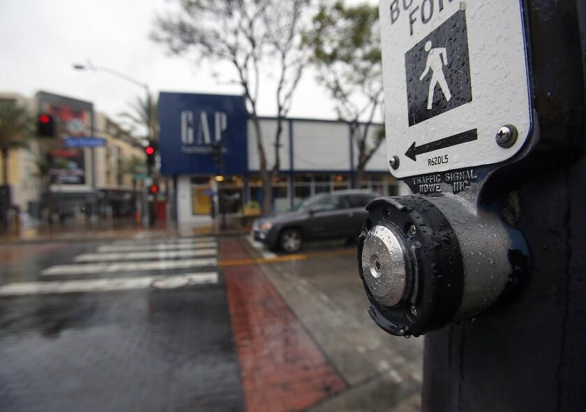 Burbank has automated the walk signal at traffic intersections in the city to cut down the need for pedestrians to press a button as a way to slow the spread of the novel coronavirus. Pictured is the crosswalk at San Fernando Boulevard and Palm Avenue on April 9, 2020.
