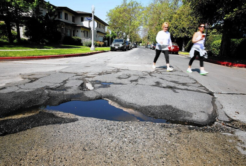 A pothole in need of repair in Hancock Park. Los Angeles is among the U.S. cities that have raised their sales taxes to pay for transportation needs.